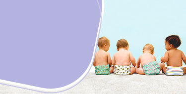 Our story page banner showing four babies sitting down wearing cloth diapers