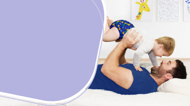 Bambino mio reusable diapers, dad laying down with baby
