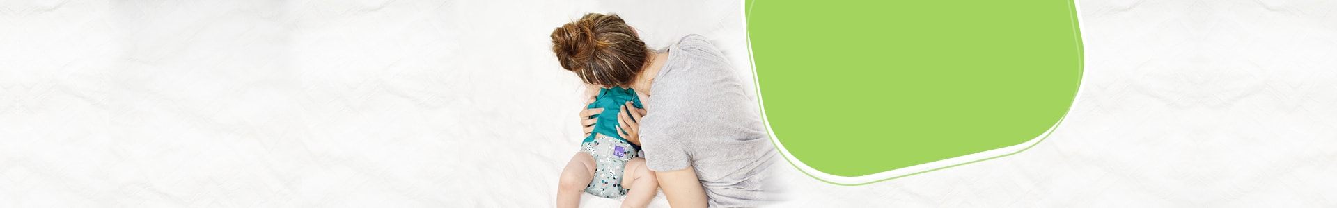 Get started with cloth diapers page banner showing mom with baby