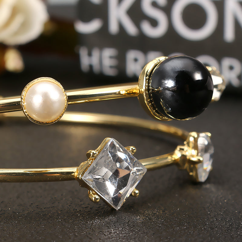JASSY®  Stylish Crystal Pearl Bangle Asymmetric Bracelets