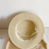 Straw hats with bow