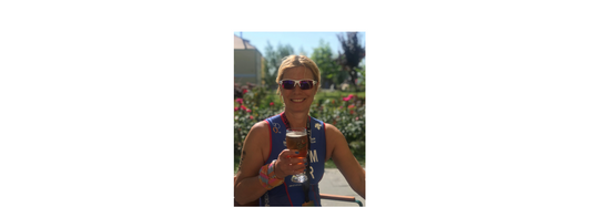 Claire Adams TeamGB Age Group triathlete enjoying a post-race beer