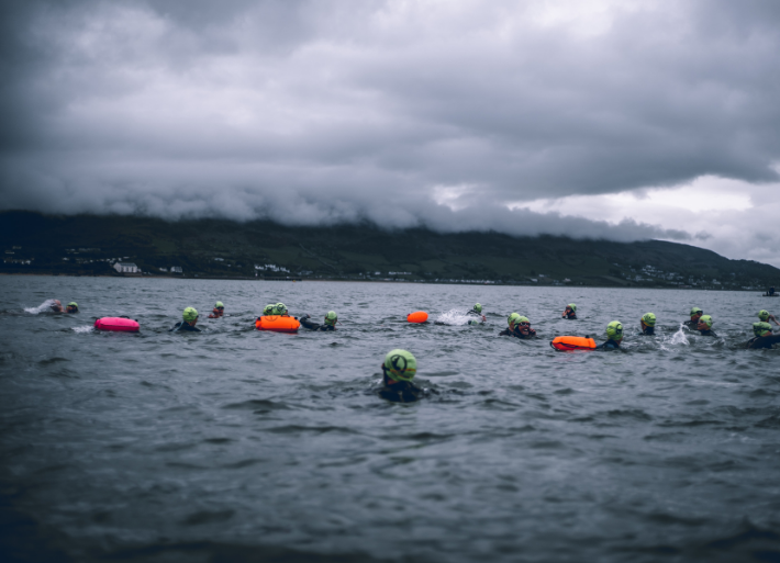 Safety swimmers in use by triathletes and open water swimmers