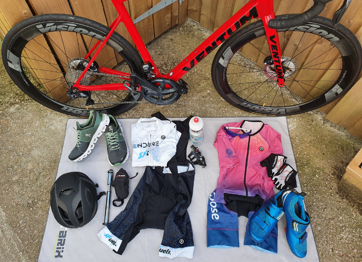 Flat lay image of triathlon bike kit