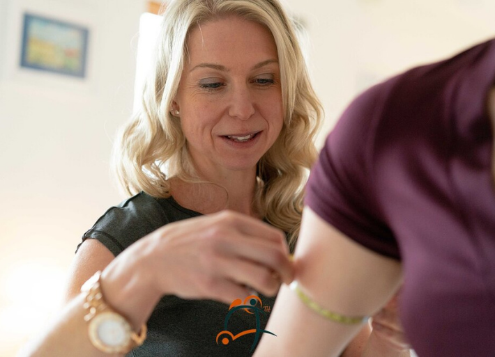 Claire Fudge sports dietician measuring body composition on an athlete