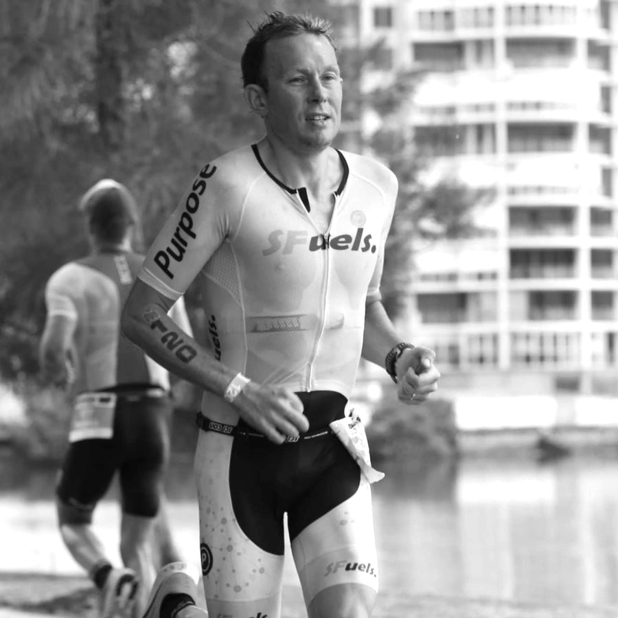Dr Dan Plews sports scientist and founder of EndureIQ running in a triathlon