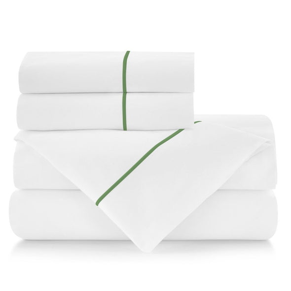 set of sheets with green piping