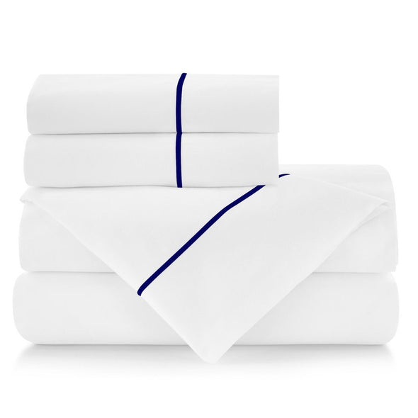 set of sheets with navy blue piping