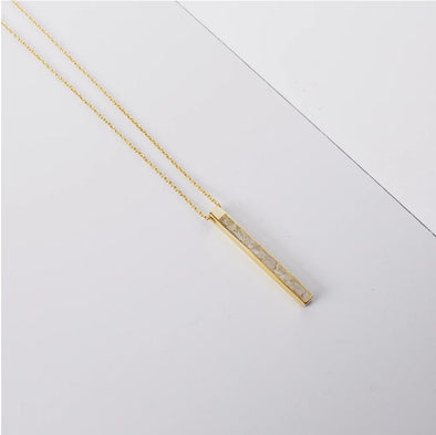 "matchstick shaped pendant with crushed diamonds on a 24"" gold chain"