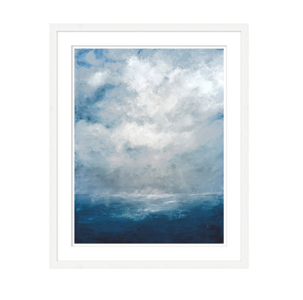 Coastal framed art of clouds over a deep blue sea with white frame