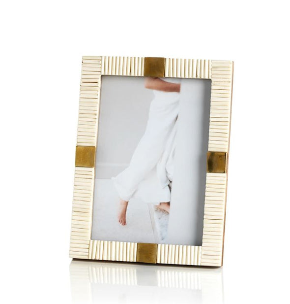textured bone photo frame with natural brass detail