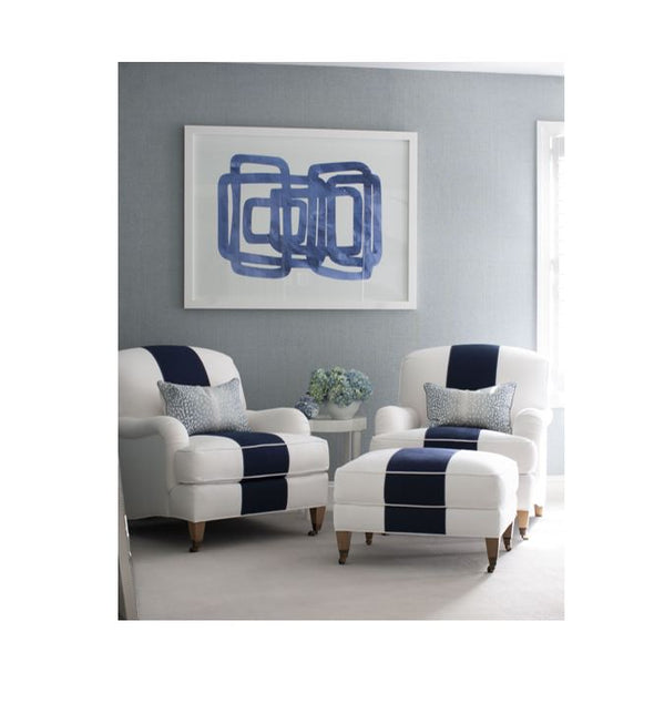 Navy and white striped lounge chairs with contemporary abstract modern navy and white art