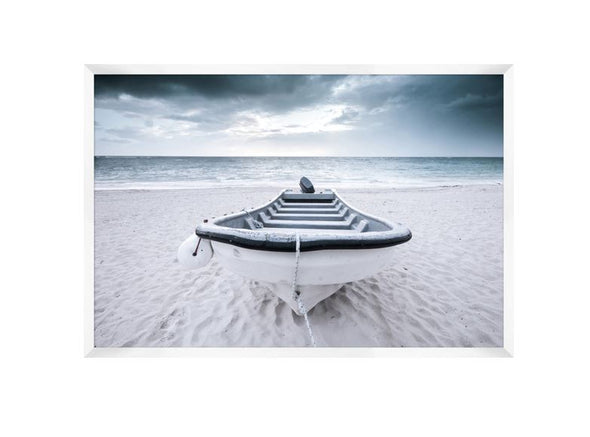 photograph of a row boat on a sandy beach