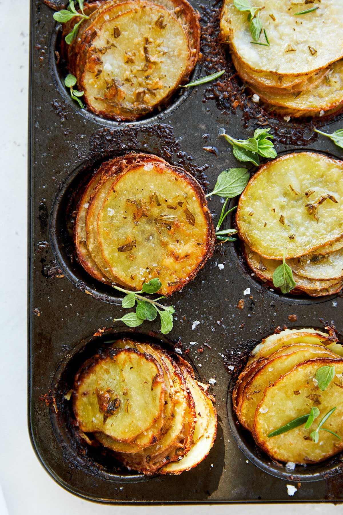 Crispy Cheesy Layered Potatoes made with Herbs and Avocado Oil