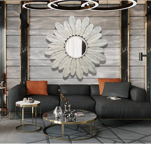 Beautiful white, metal decorative flower mirror above couch