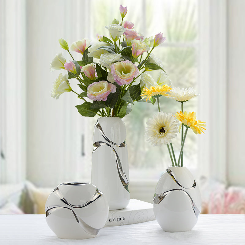 Artistic white and silver flower vases