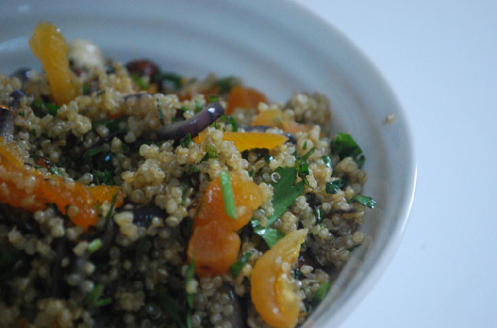 Quinoa with hazelnuts, orange, onion and herbs