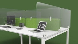 Office desks fitted with office screens to enable social distancing