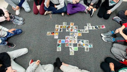 A grade two class playing OuiSinoes, and sharing creativity and building conversation skills.