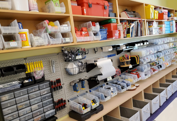 Classroom shelves full of tools for creativity and learning.