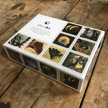 Load image into Gallery viewer, Close up side-angle shot of OuiSi game box