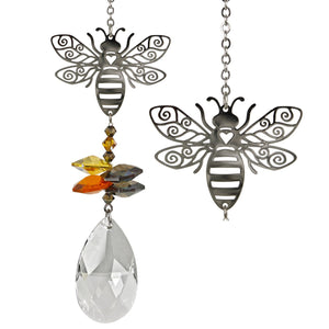 A social animal, the bee symbolizes community. In many cultures, the bee is considered to be a messenger, carrying news to the spirit world. This bee tops a cluster of crystals that sparkle and shine in the sun.