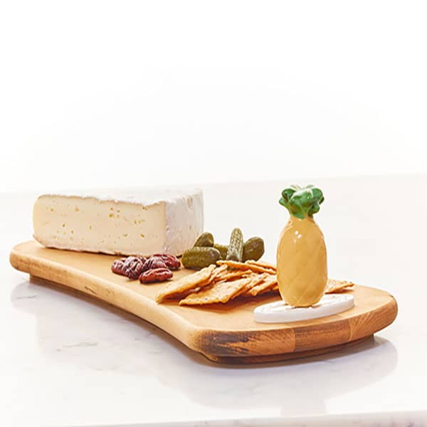 Welcome Friends! - Nora Fleming pineapple mini, shown on wooden cheese board