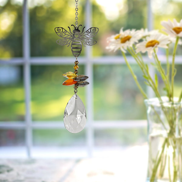 this bee suncatcher is made with beautiful Austrian Crystals. A social animal, the bee symbolizes community. In many cultures, the bee is considered to be a messenger, carrying news to the spirit world. This bee tops a cluster of crystals that sparkle and shine in the sun.