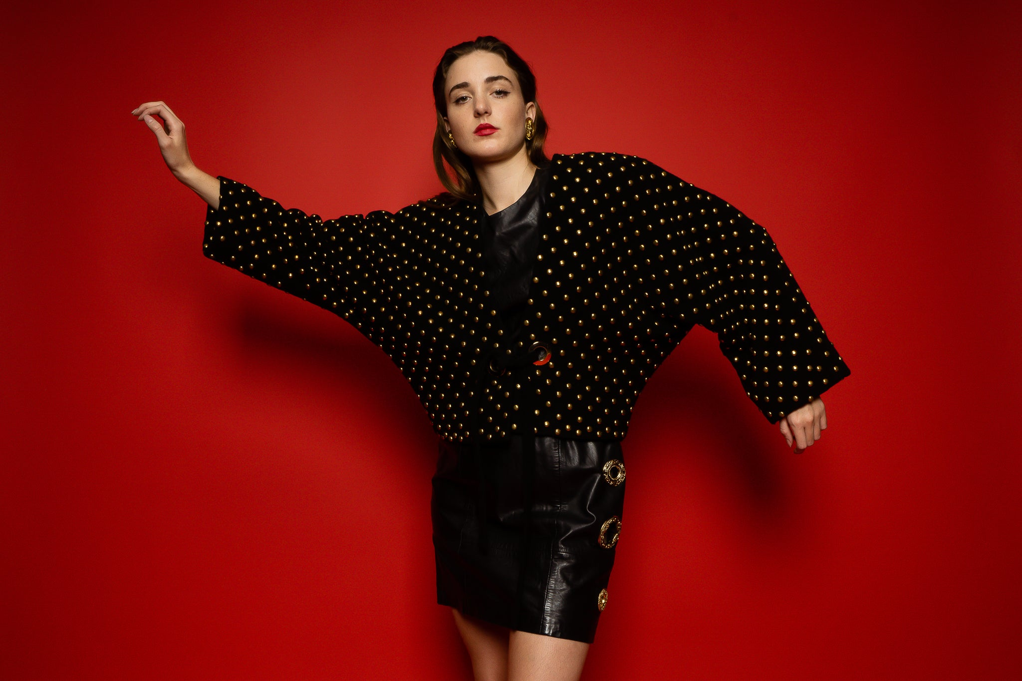 Girl in Anne Klein studded tie jacket & Chanel boots on red at Recess Los Angeles