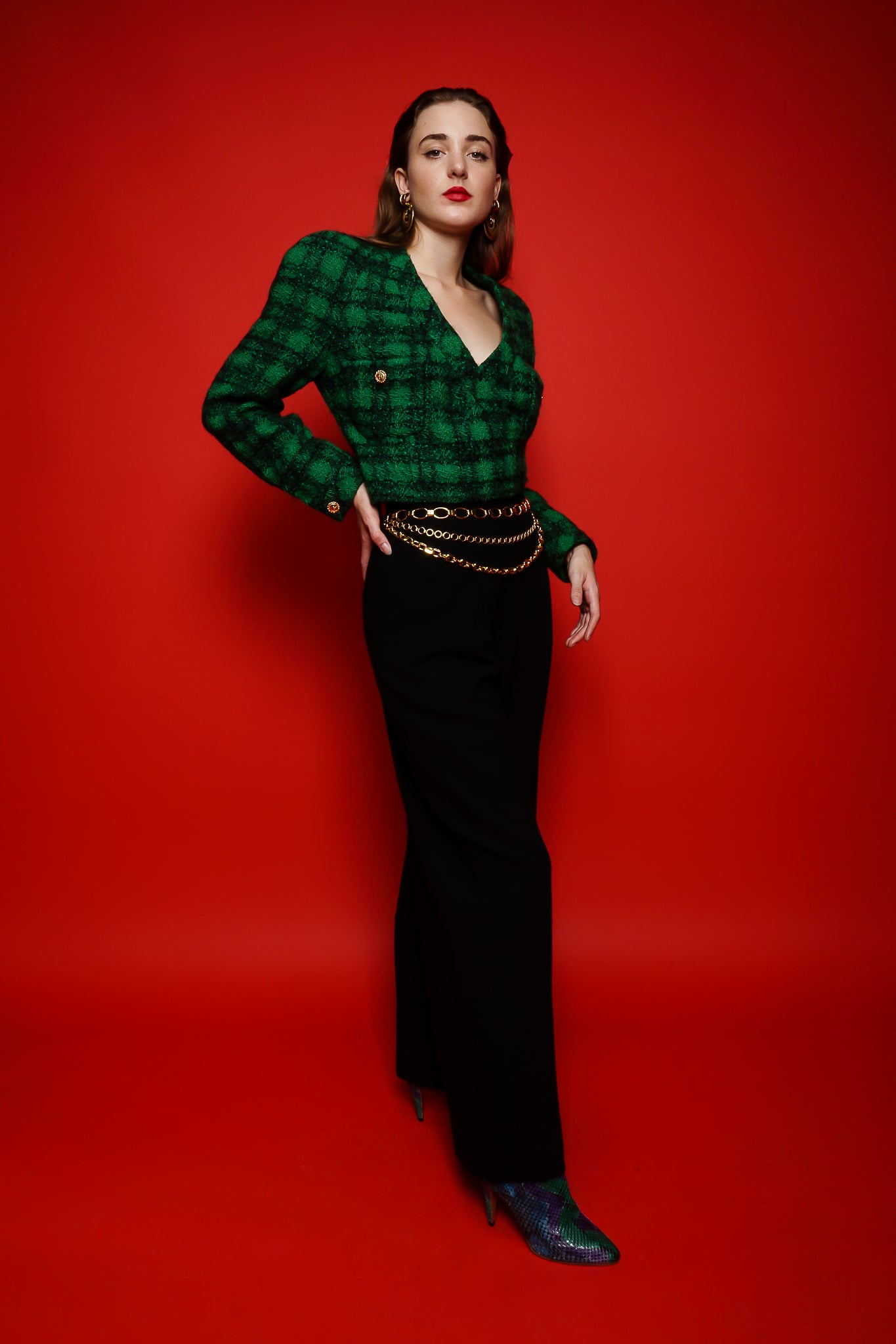 Girl in green Chanel plaid tweed wrap jacket & Todd Oldham pants on red at Recess Los Angeles