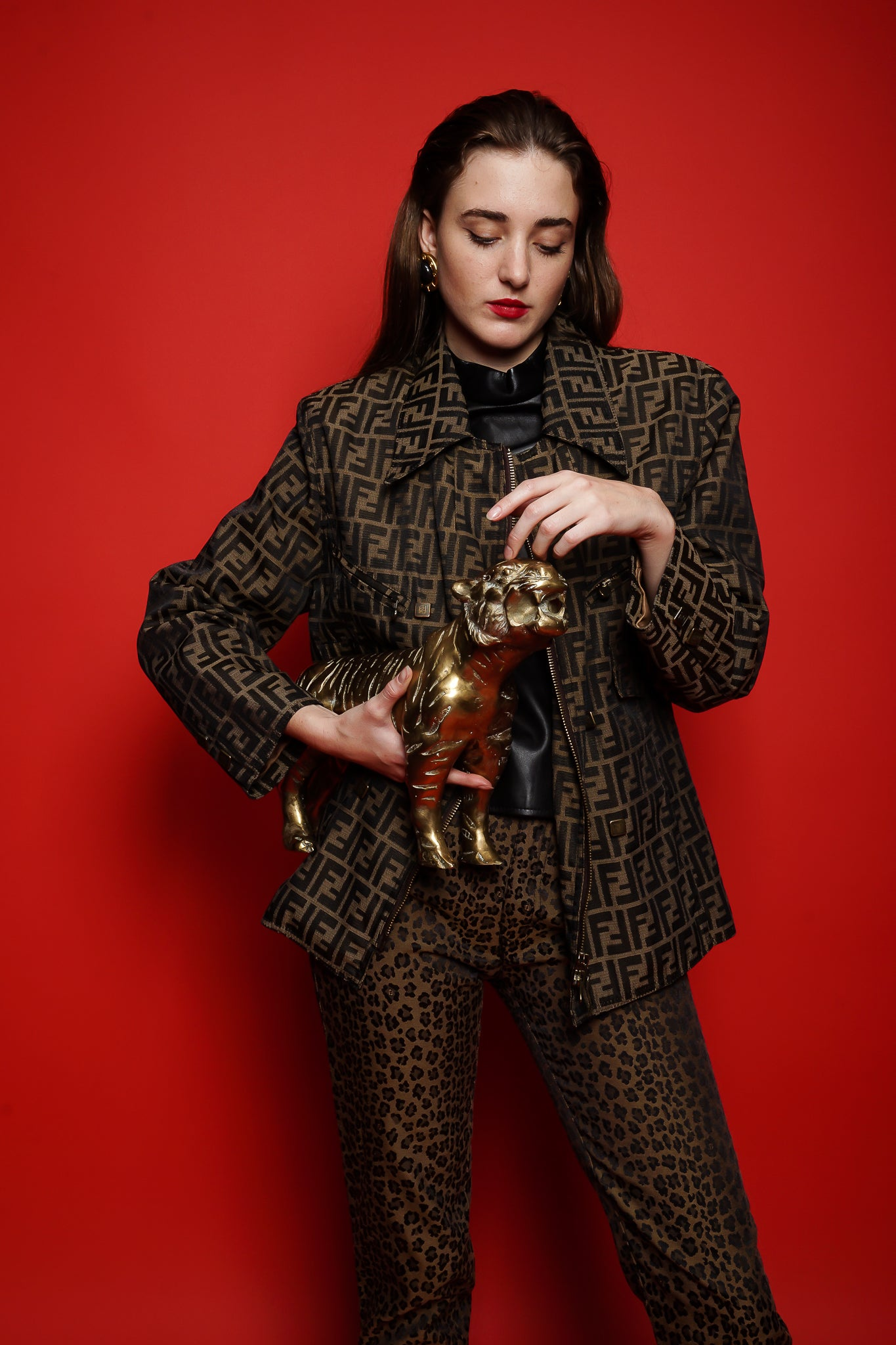 Girl in Fendi Zucca twill zip jacket and animal pant with brass cat at Recess Los Angeles