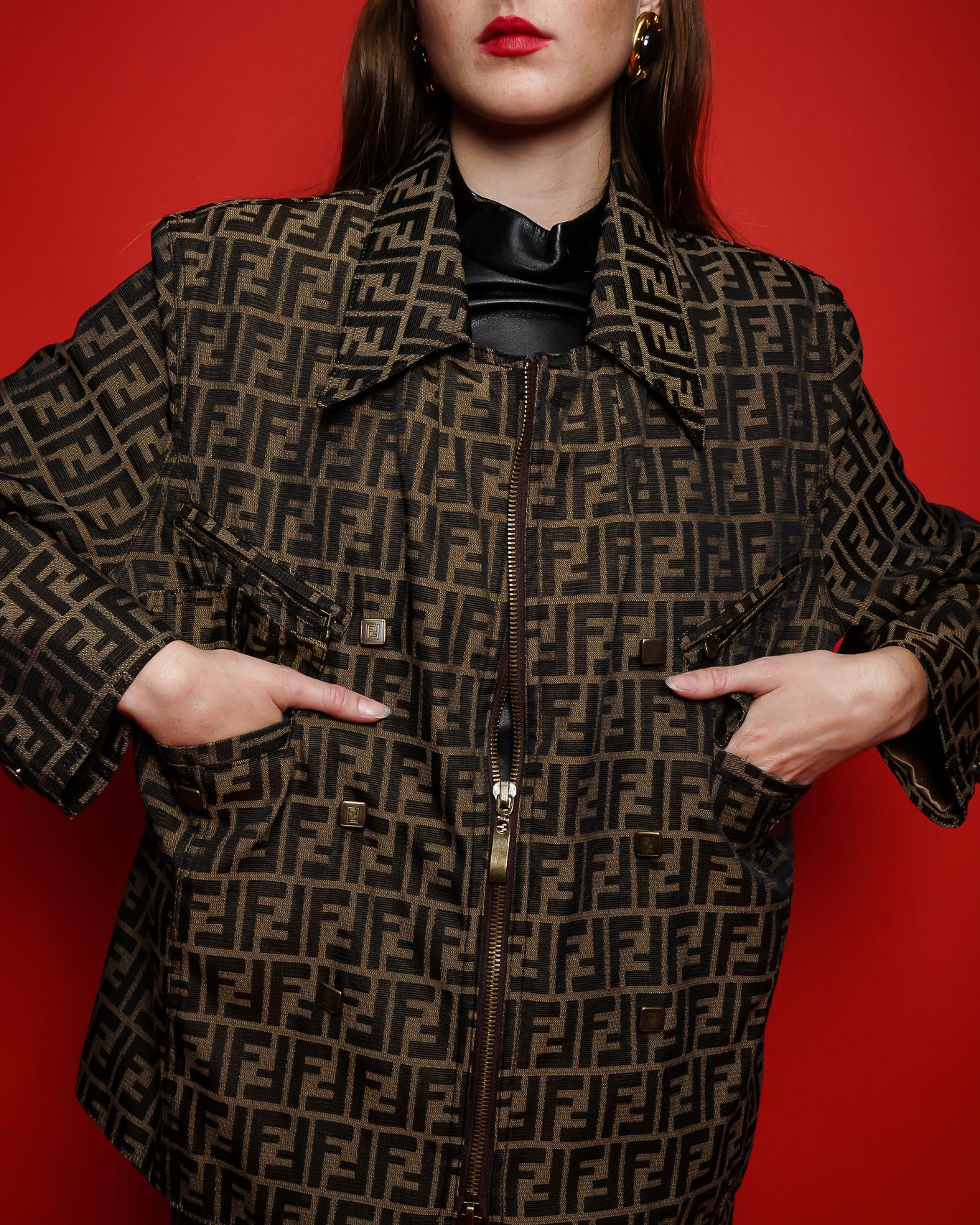 Girl in Fendi Zucca twill zip jacket on red background at Recess Los Angeles