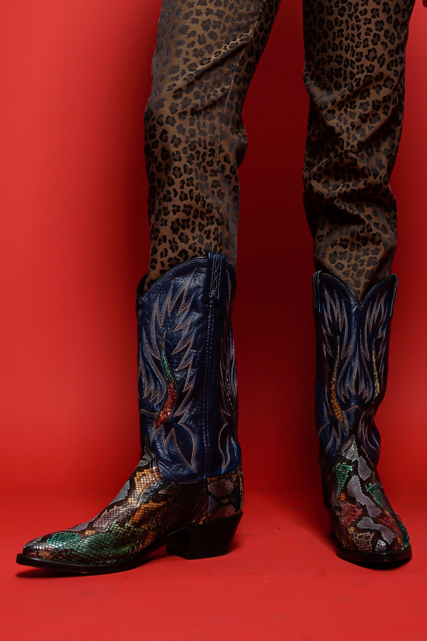 Fendi animal pant and multicolor snakeskin flame boots on red background at Recess Los Angeles