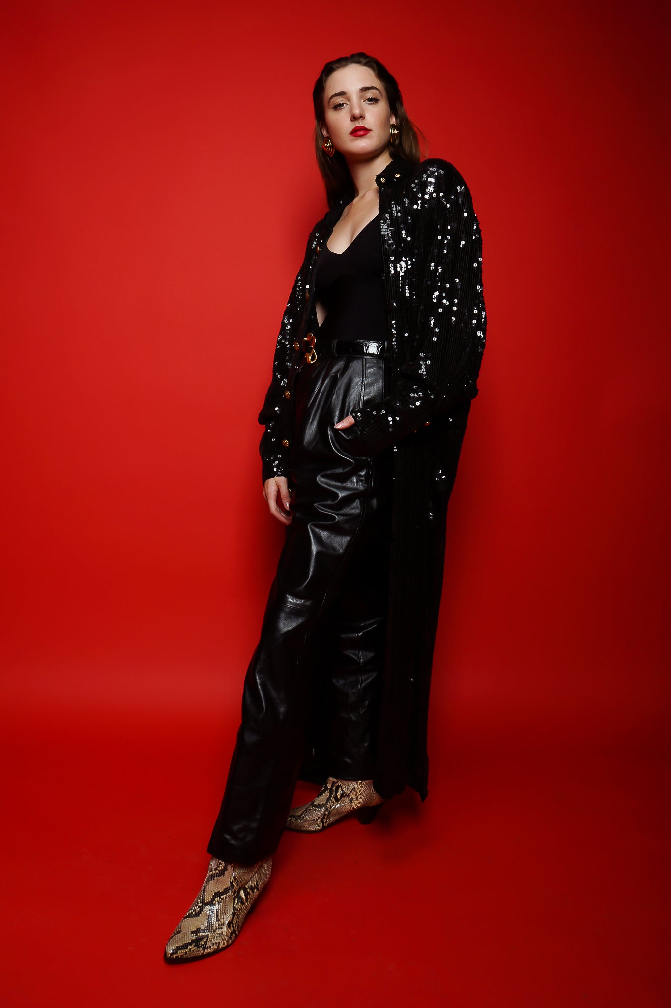 Girl in black Jeanette St Martin sequin duster & YSL leather pant on red at Recess Los Angeles