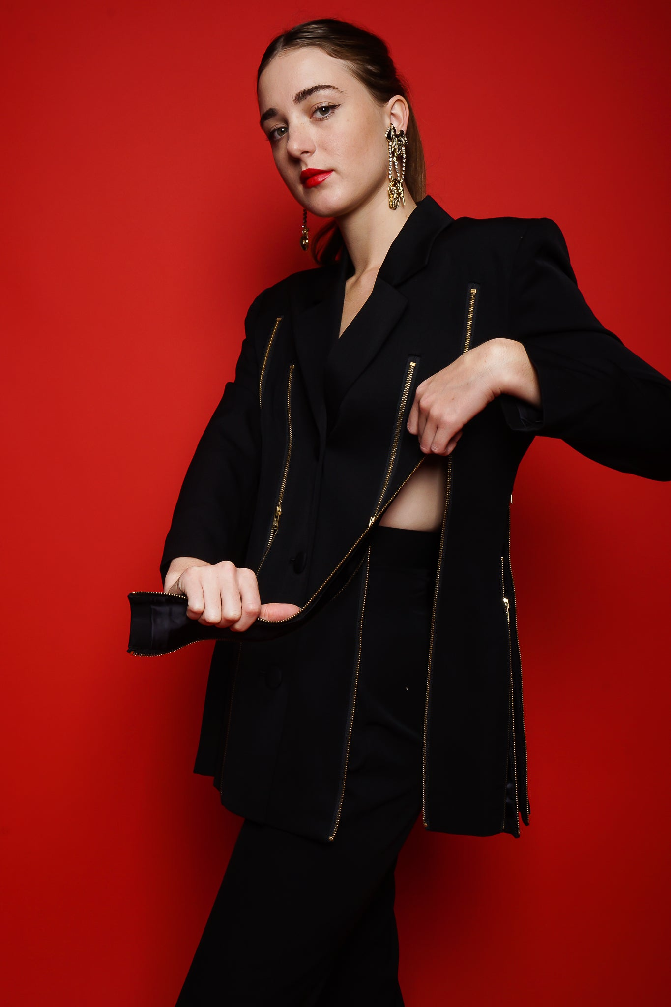 Girl in M.Yoko Japan Zippered Carwash Slit Jacket on red background at Recess Los Angeles