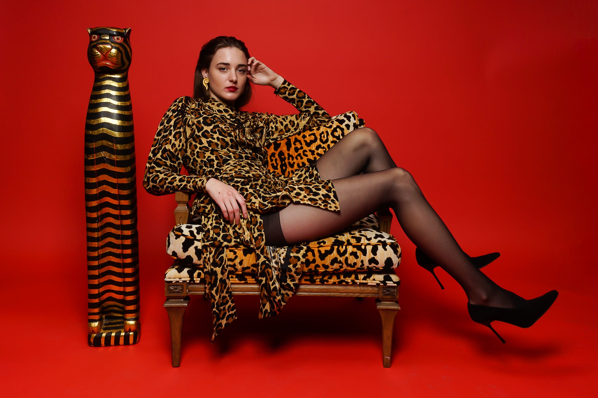 Girl in YSL Yves Saint Laurent Leopard Scarf Dress in animal chain on red at Recess Los Angeles