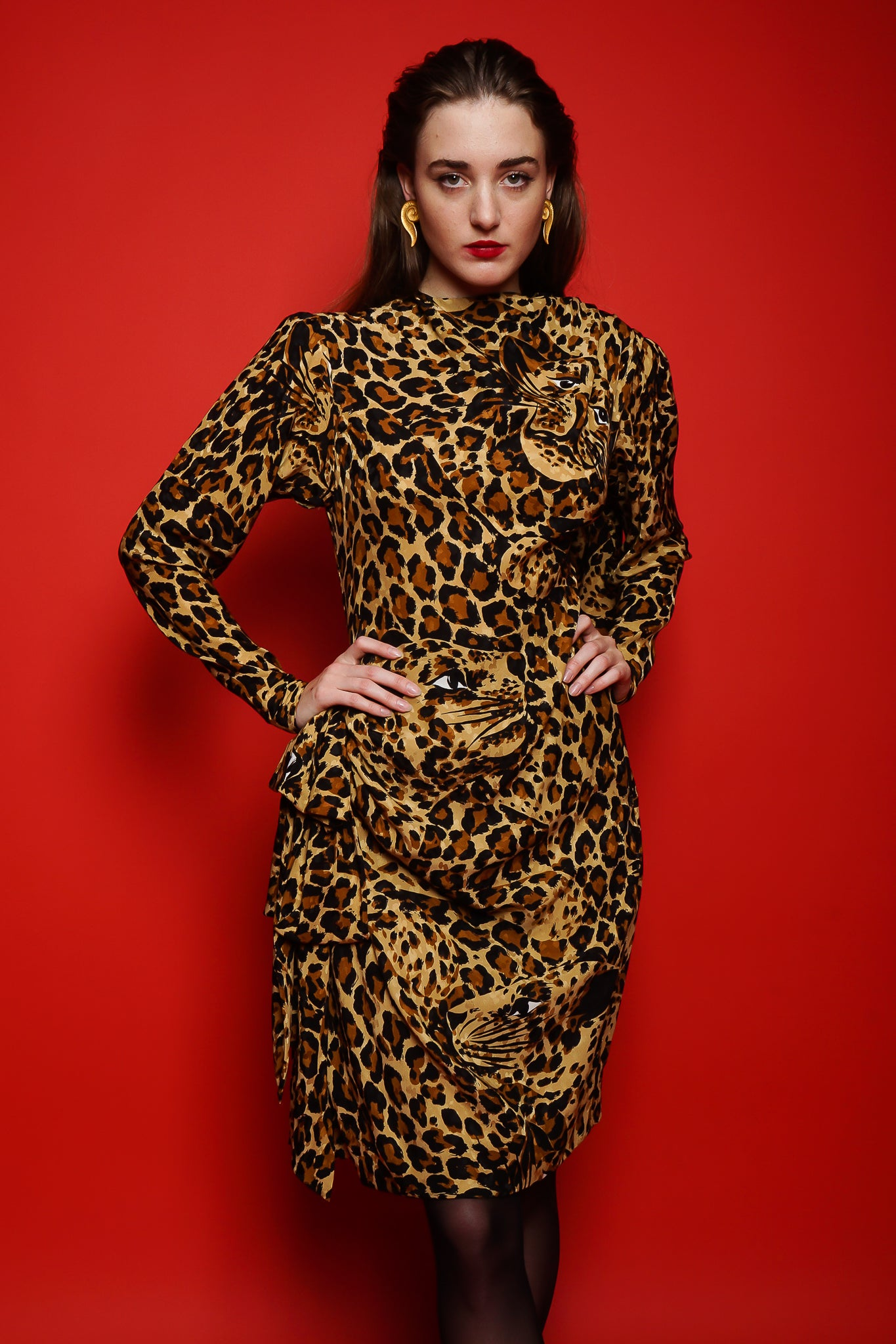 Girl in YSL Yves Saint Laurent Leopard Scarf Dress on red background at Recess Los Angeles