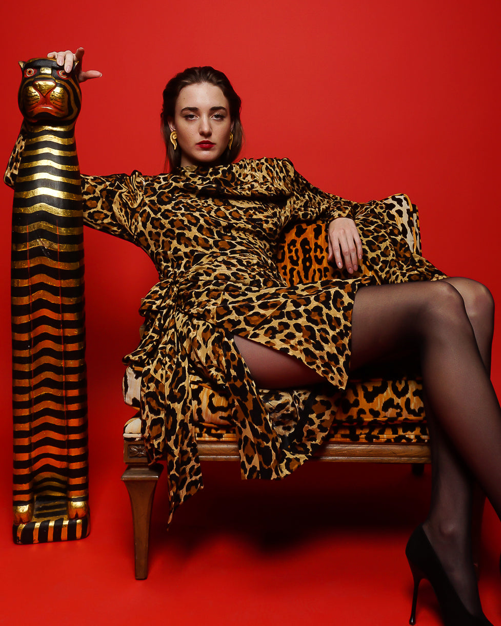 Girl in YSL Yves Saint Laurent Leopard Scarf Dress in animal chair on red at Recess Los Angeles