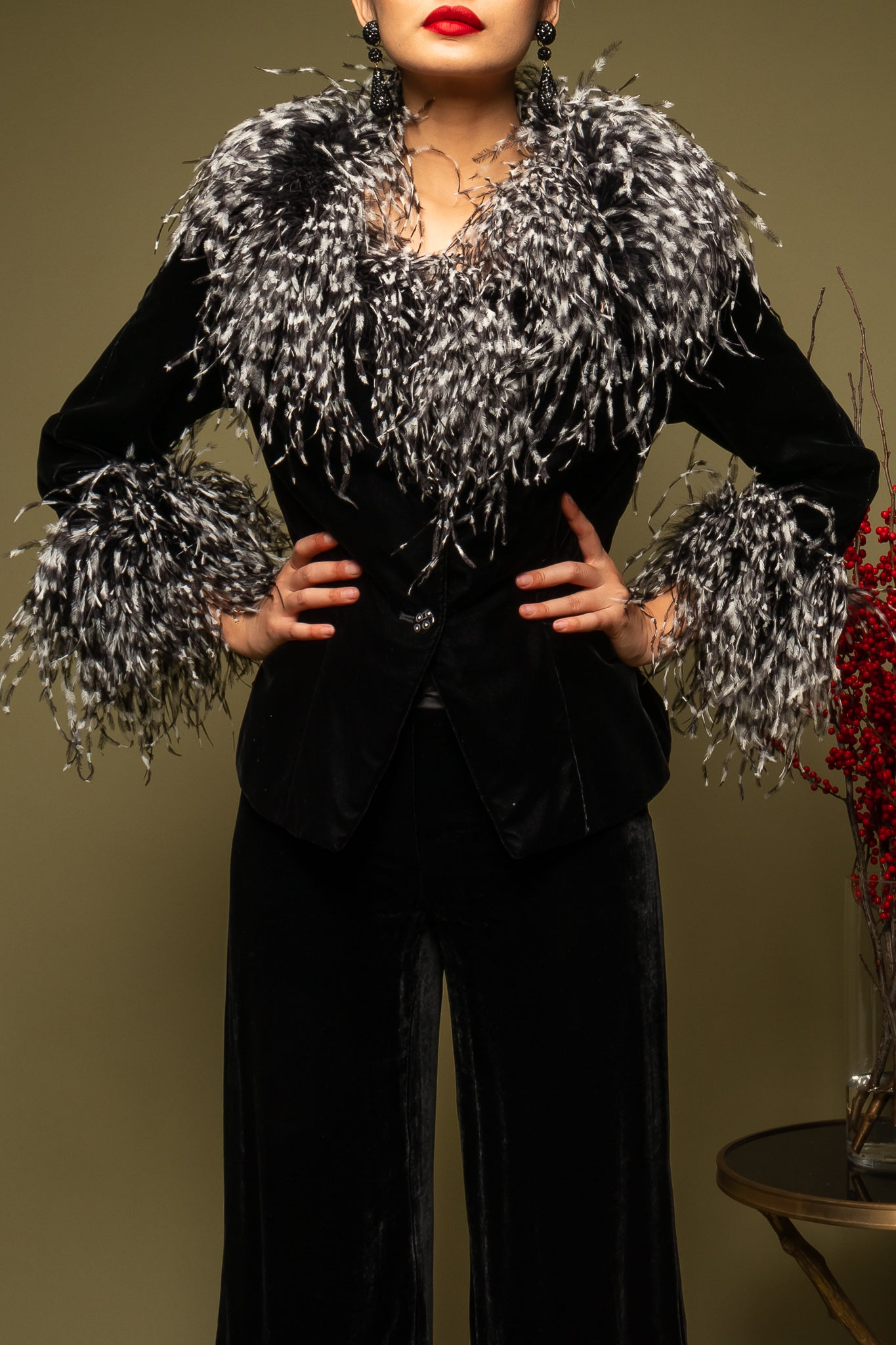 girl in Bob Mackie b&w feather jacket & Armani Collezioni pant on green @ Recess Los Angeles