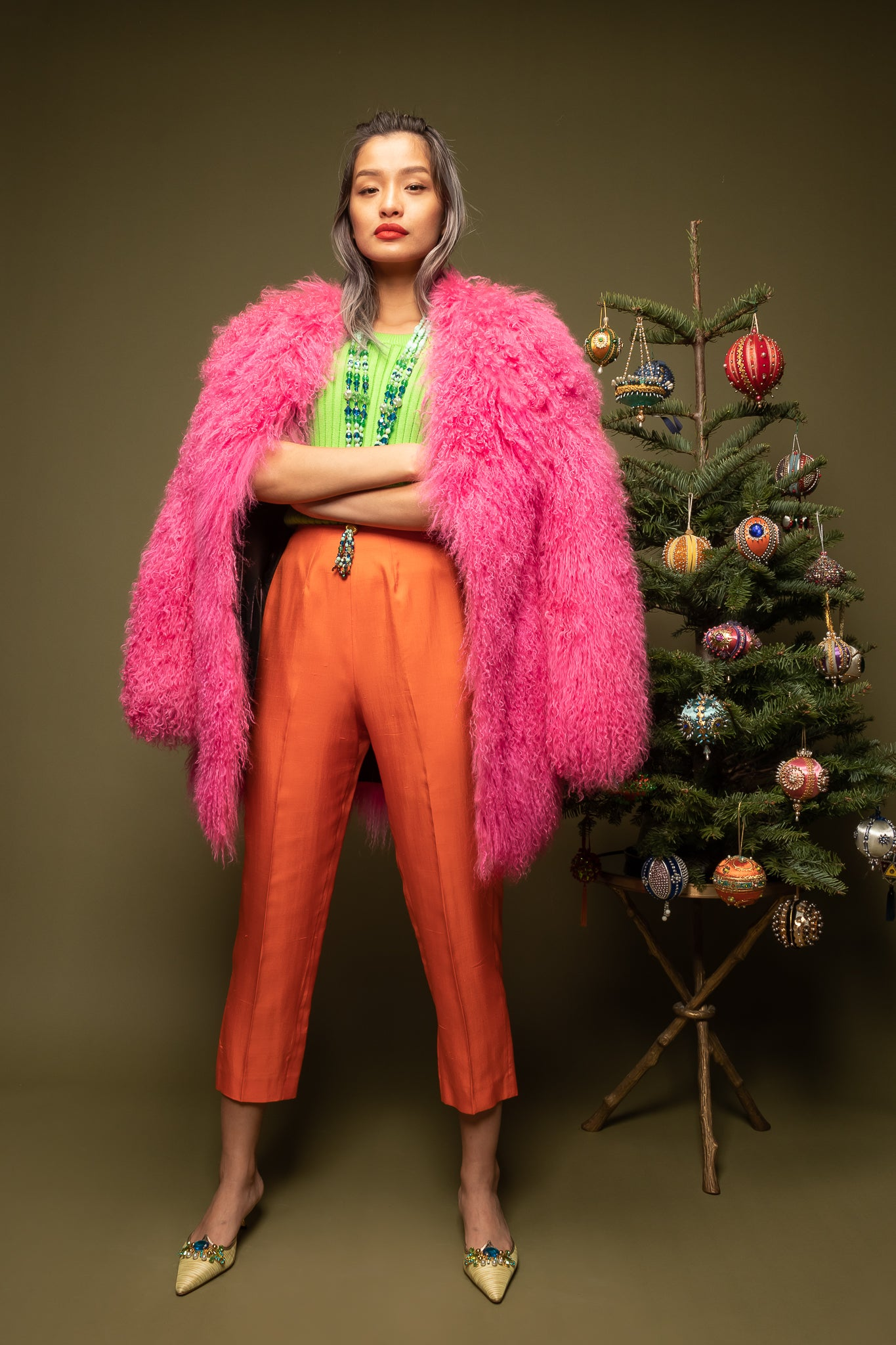 girl in Krizia hot pink mongolian fur and orange pant on green @ Recess Los Angeles