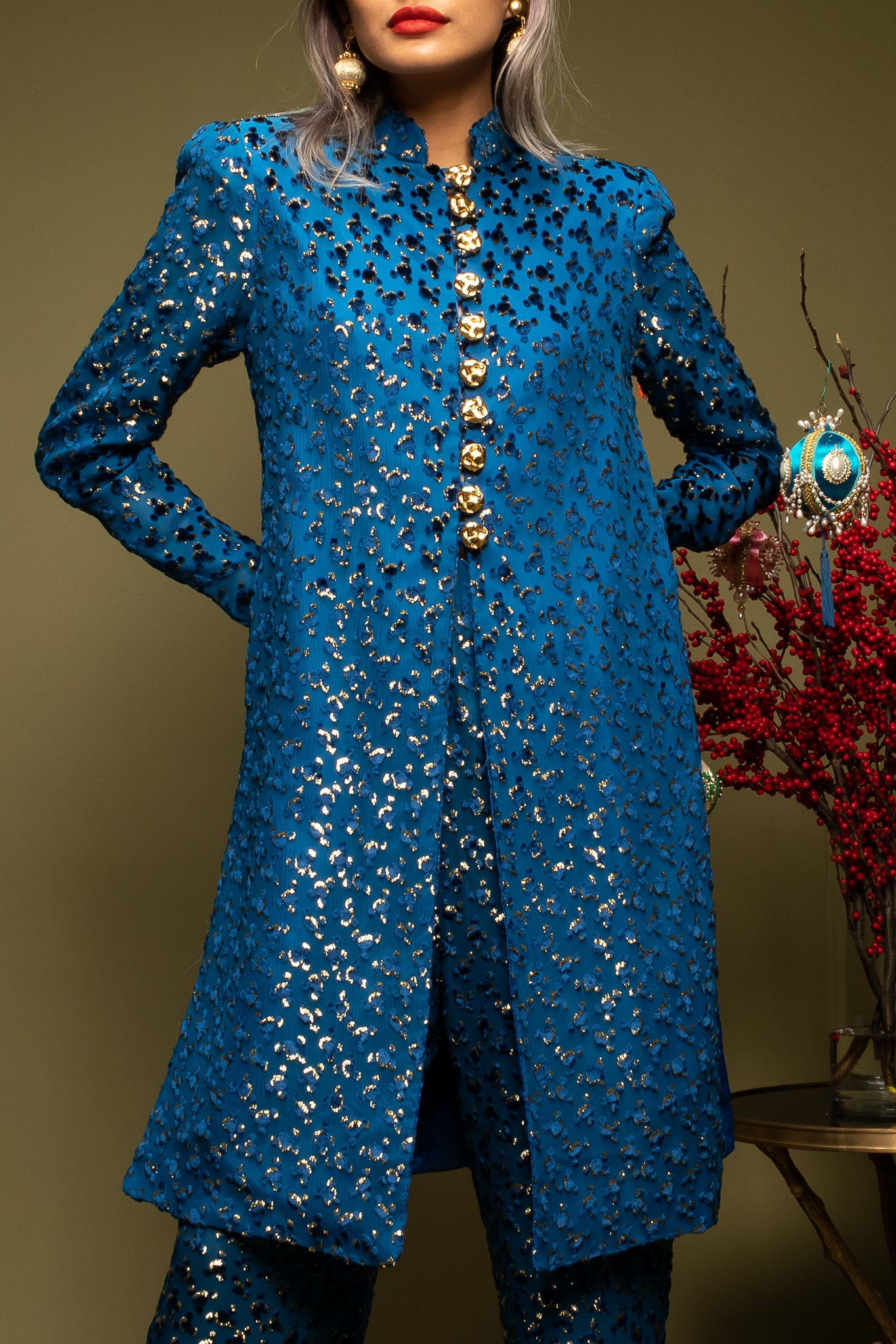 girl in blue brocade Richilene moroccan pant set on green @ Recess Los Angeles