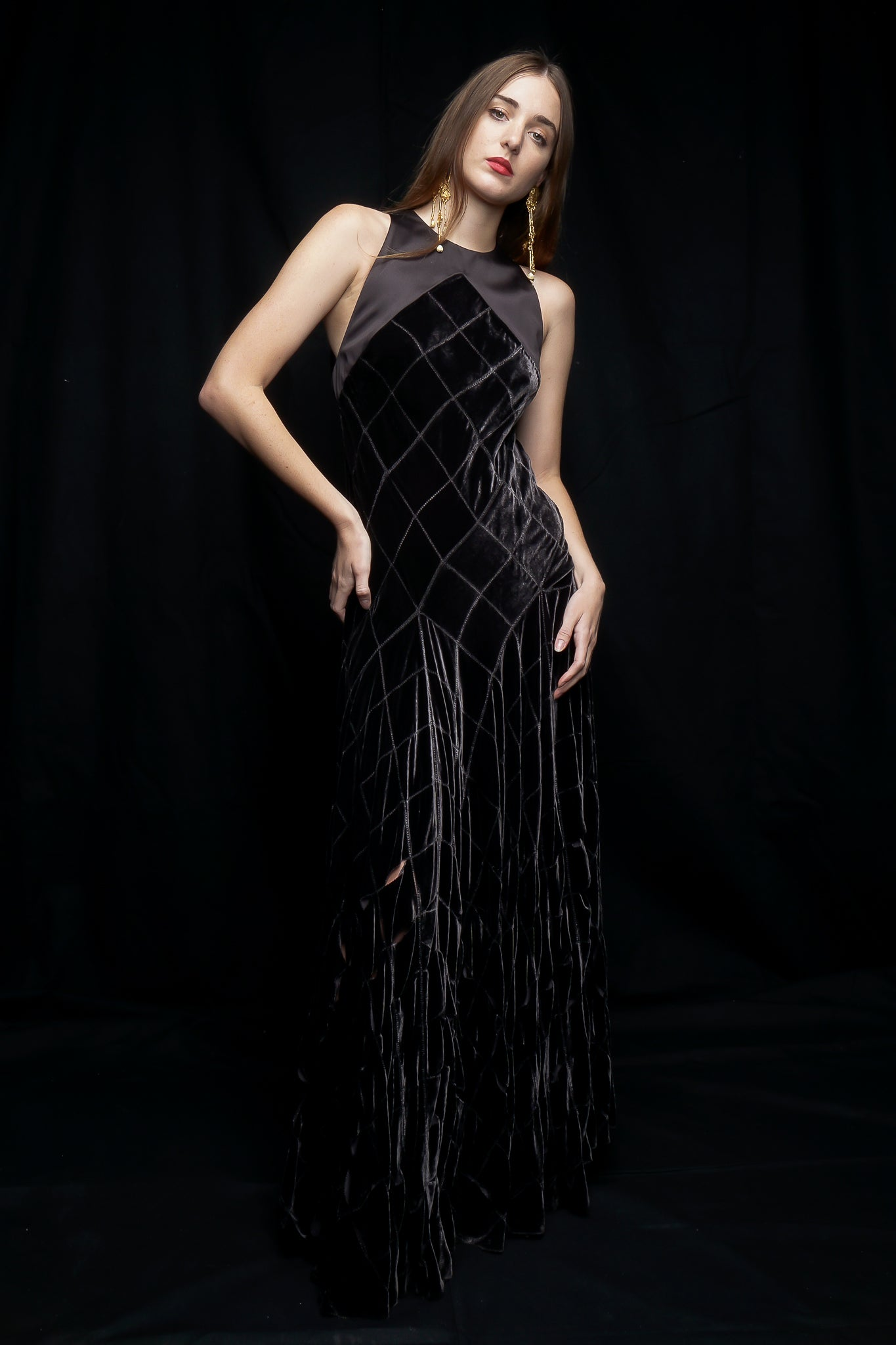 Girl wearing charcoal Calvin Klein gown at Recess LA Designer Vintage Consignment