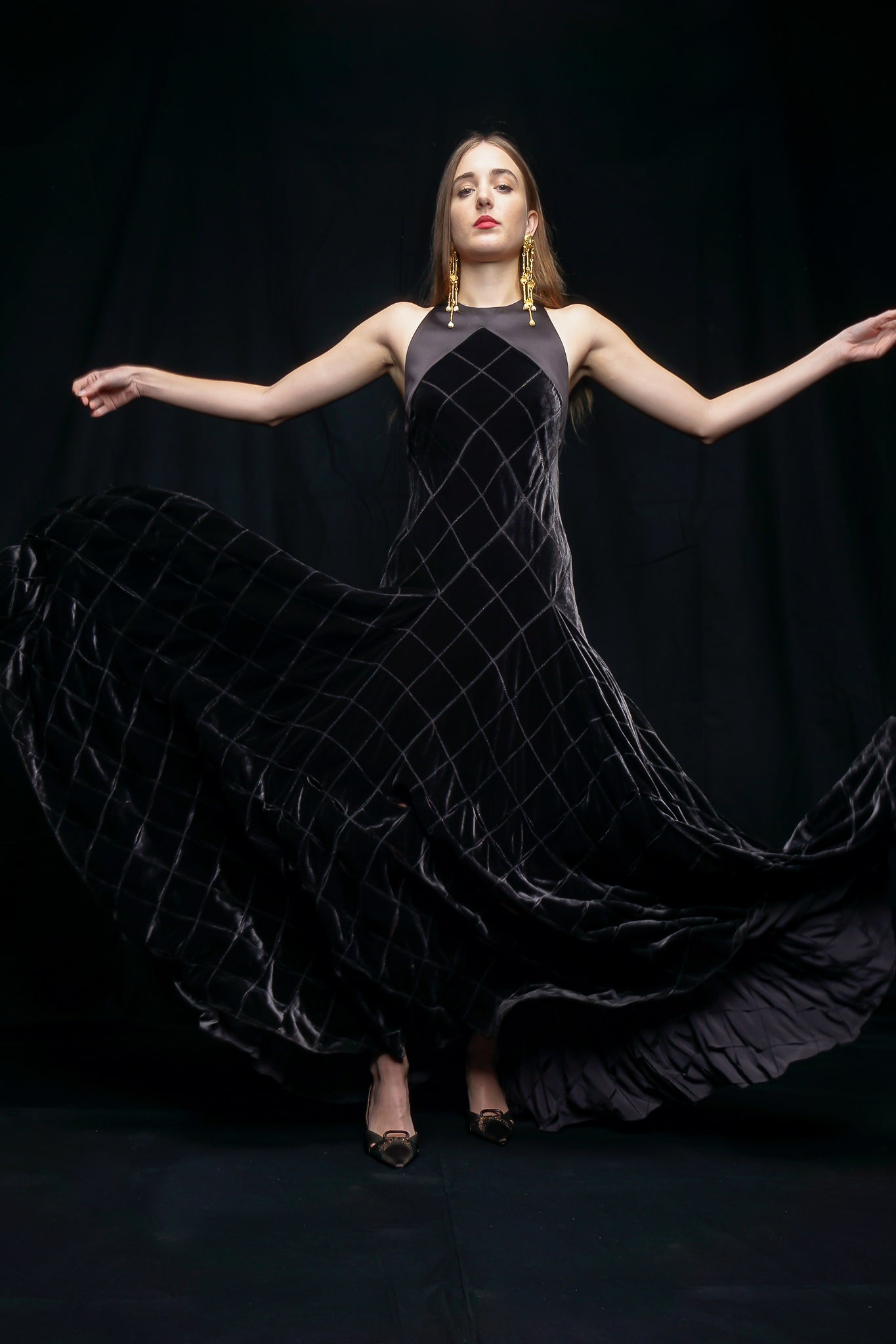 Girl wearing charcoal Calvin Klein gown swoosh at Recess LA Designer Vintage Consignment