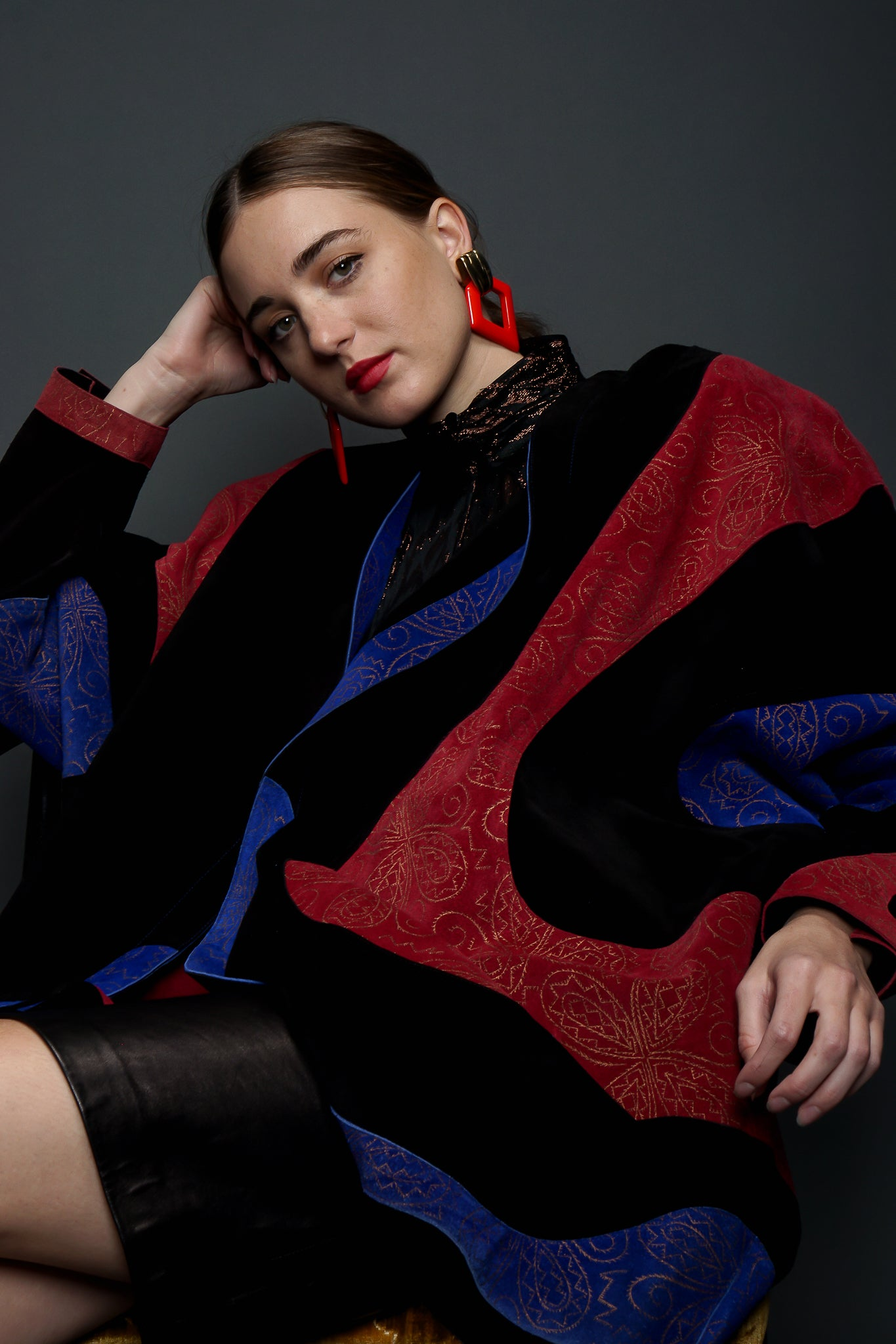 Girl in red/blue Suede Jean Muir Cocoon Coat & YSL leather skirt sitting at Recess LA Vintage