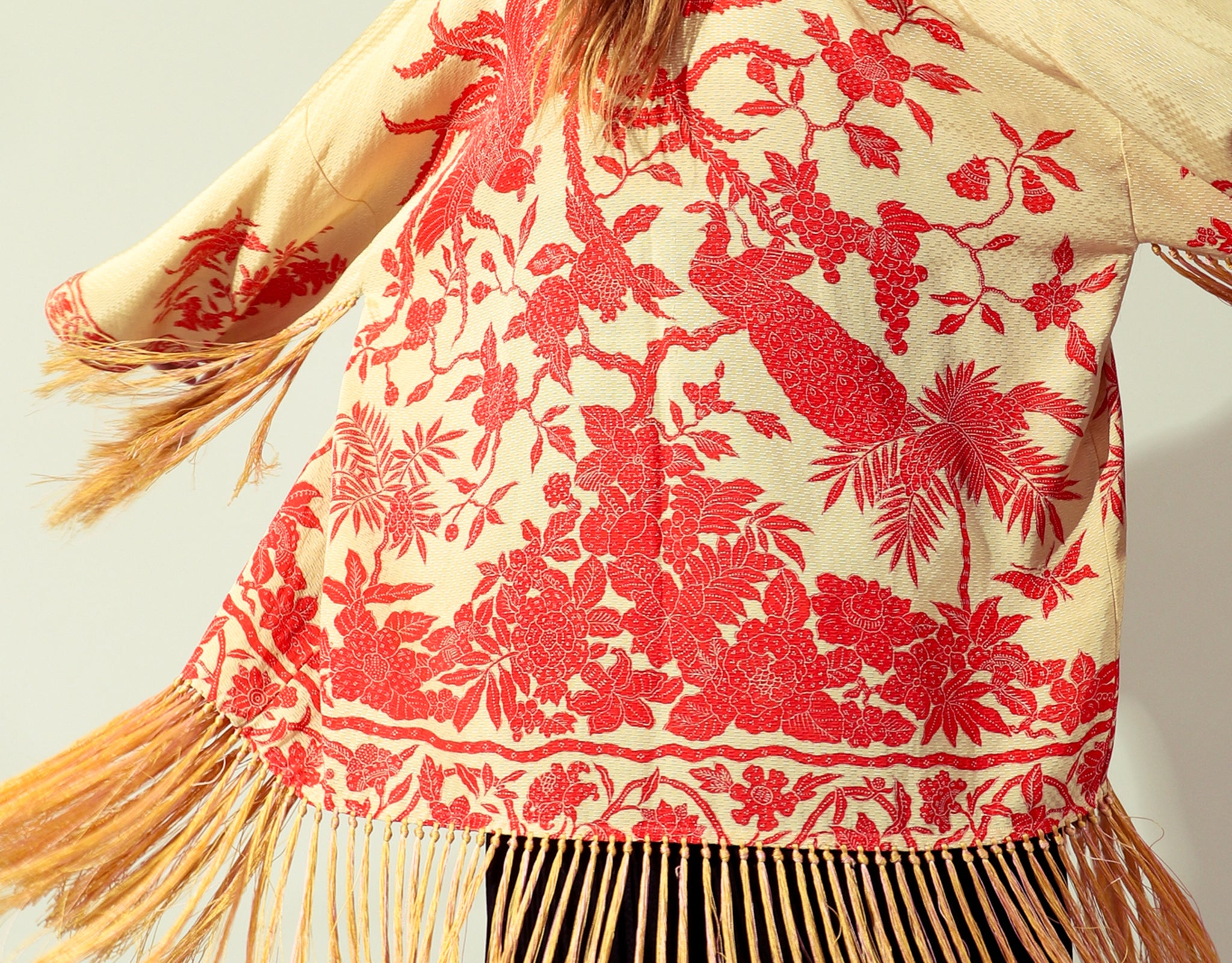 Girl in vintage fringe red kimono and lace dress at Recess Los Angeles
