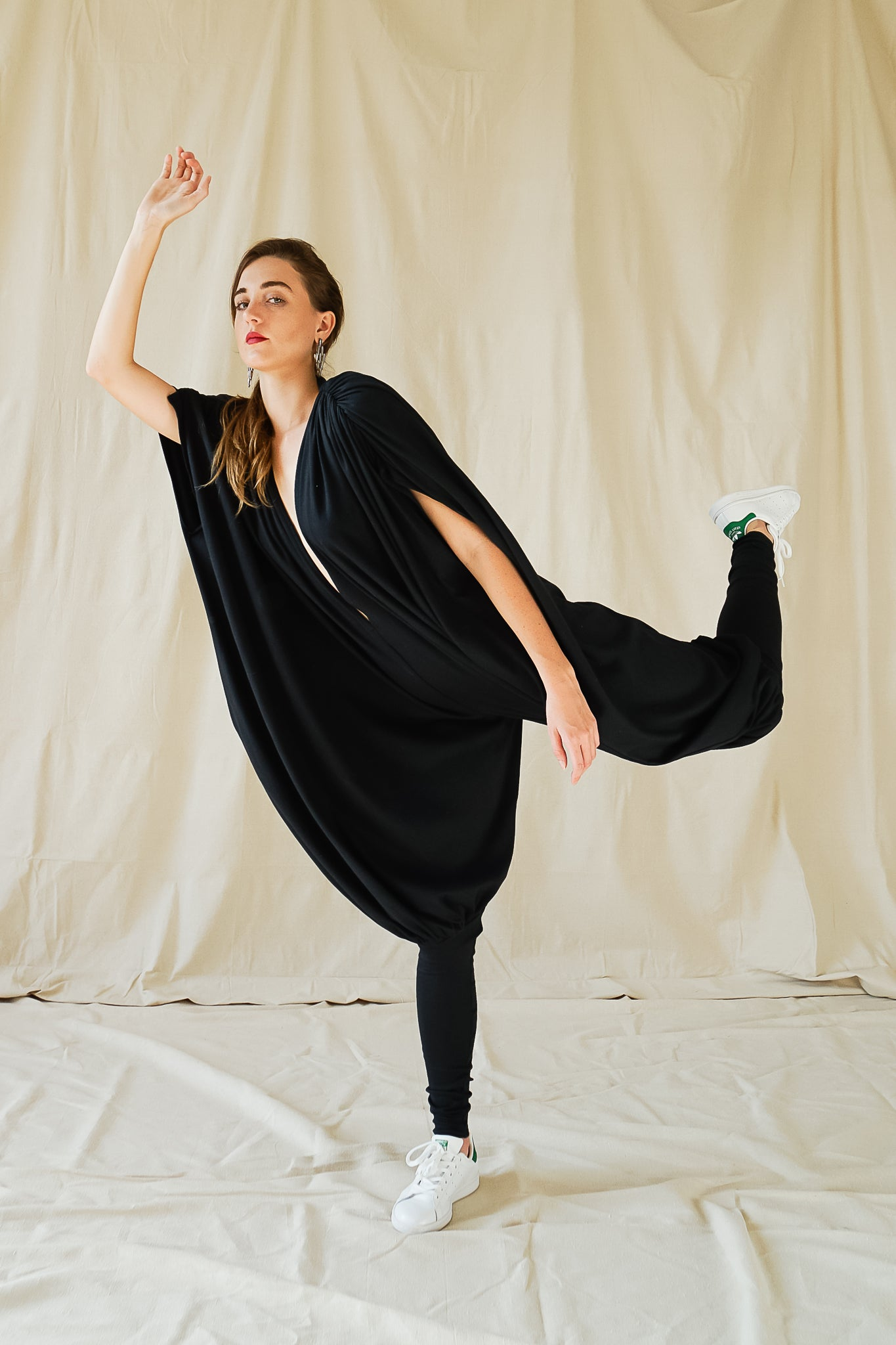 Recess Vintage Consignment Girl wearing black Norma Kamali iconic 80s bubble jersey knit jumpsuit