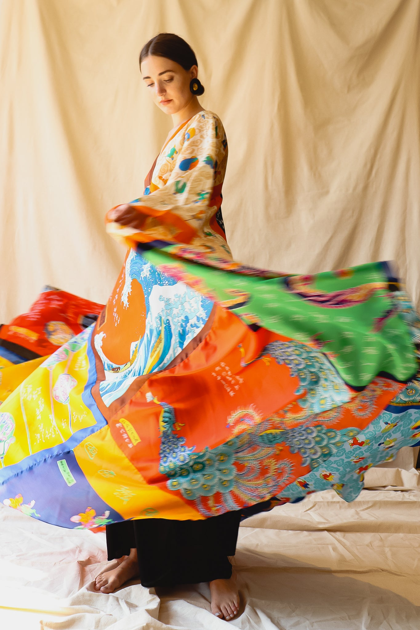 Recess Vintage Consignment LA Girl twirling in colorful silk La Vetta Patchwork dress