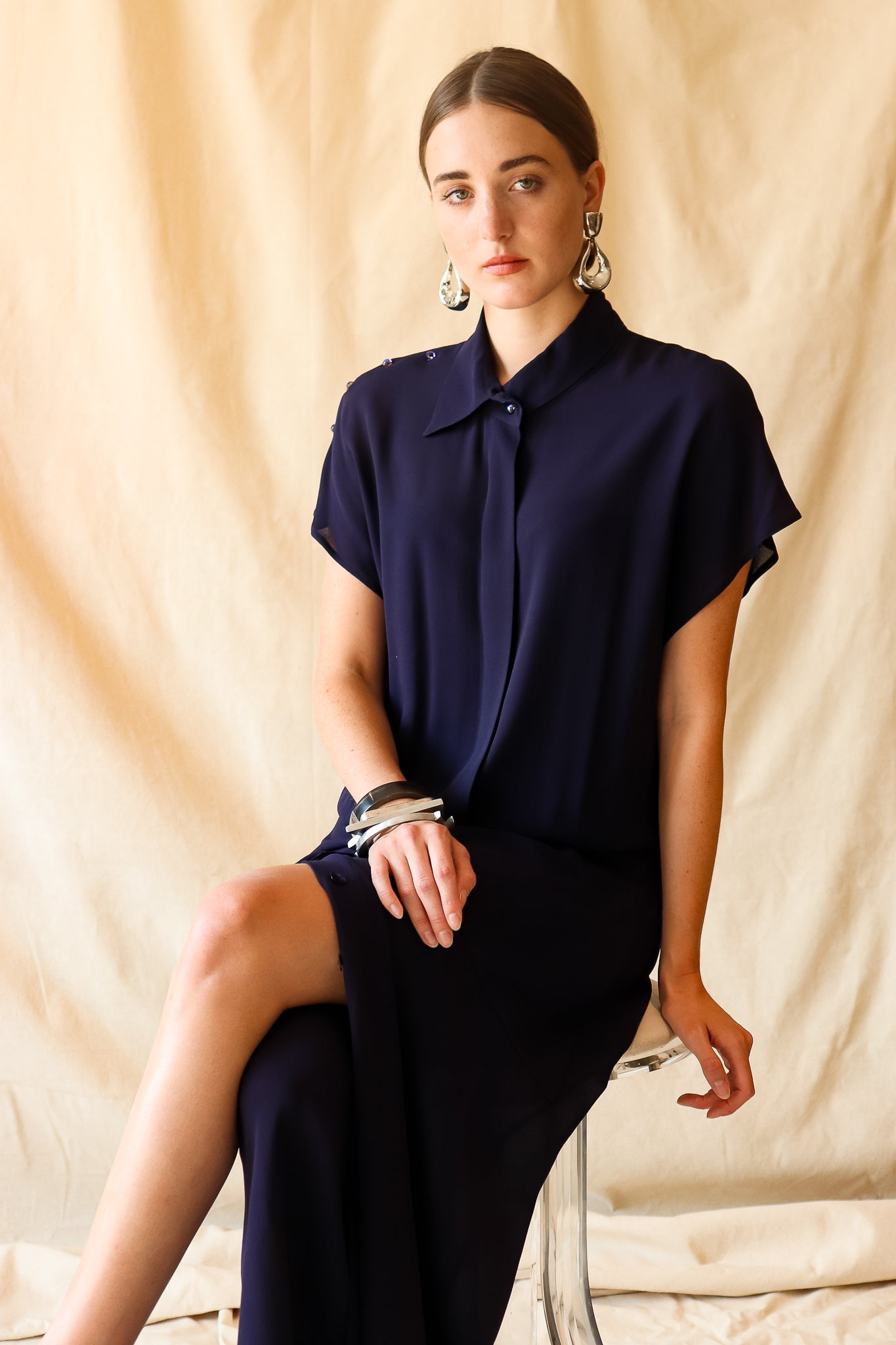 Recess Vintage Consignment LA Girl sitting in sheer navy Karl Lagerfeld Dress