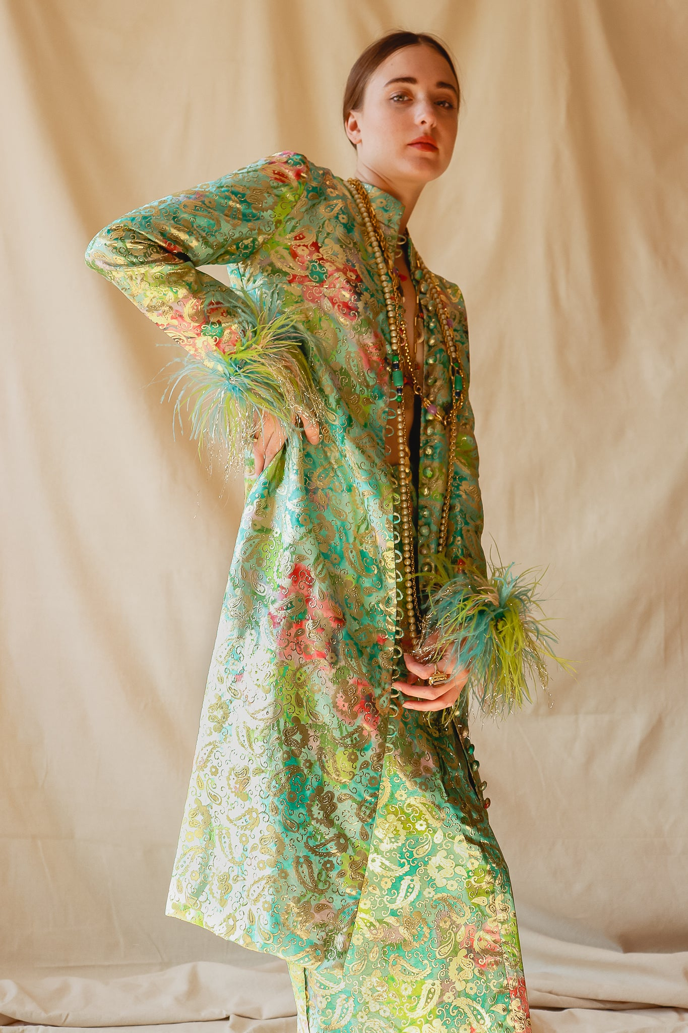 Recess Vintage Consignment Girl in green brocade Victor Costa feather jacket set