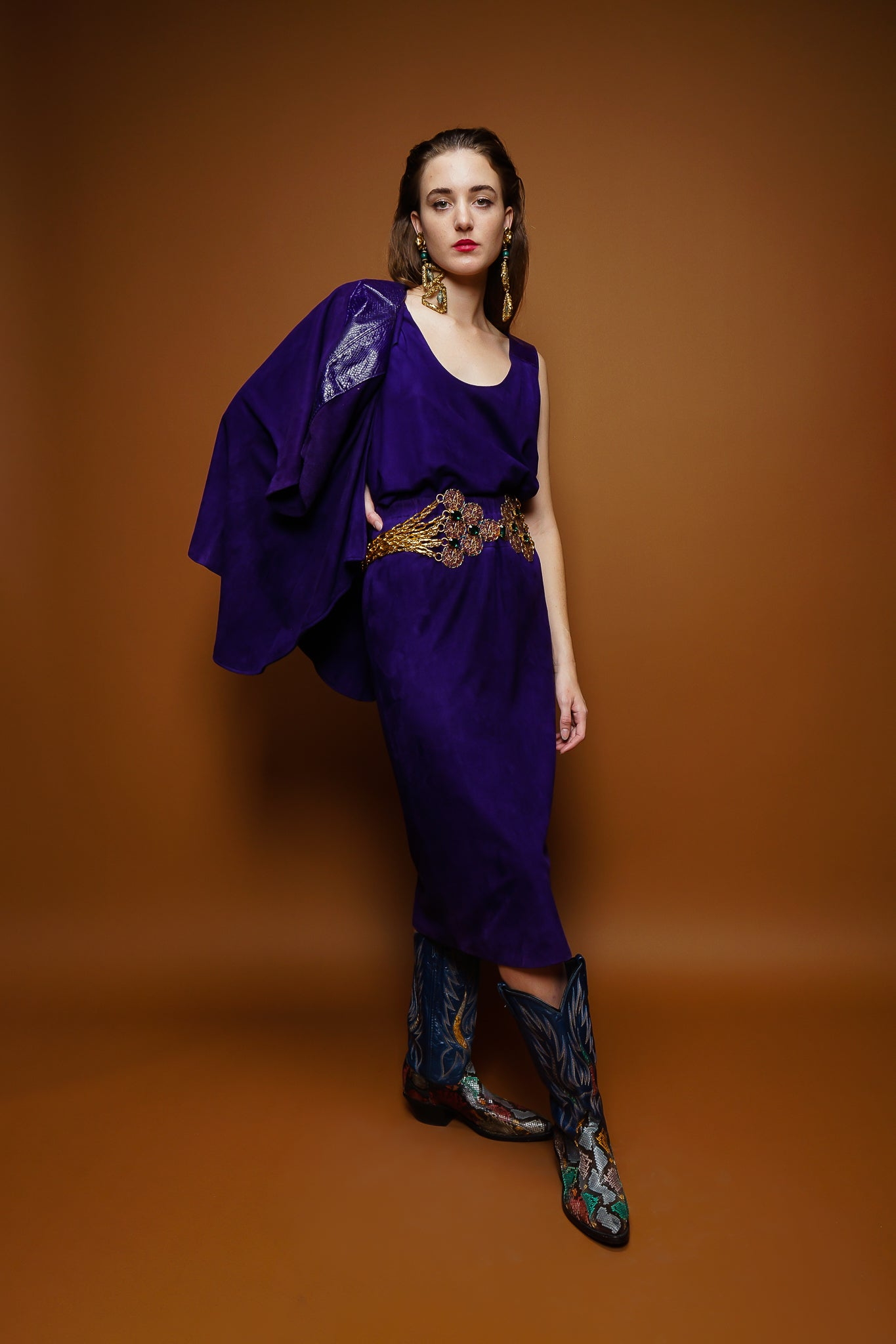 girl in Abbe Magre purple tissue suede ensemble and cowboy boots on brown @ Recess Los Angeles